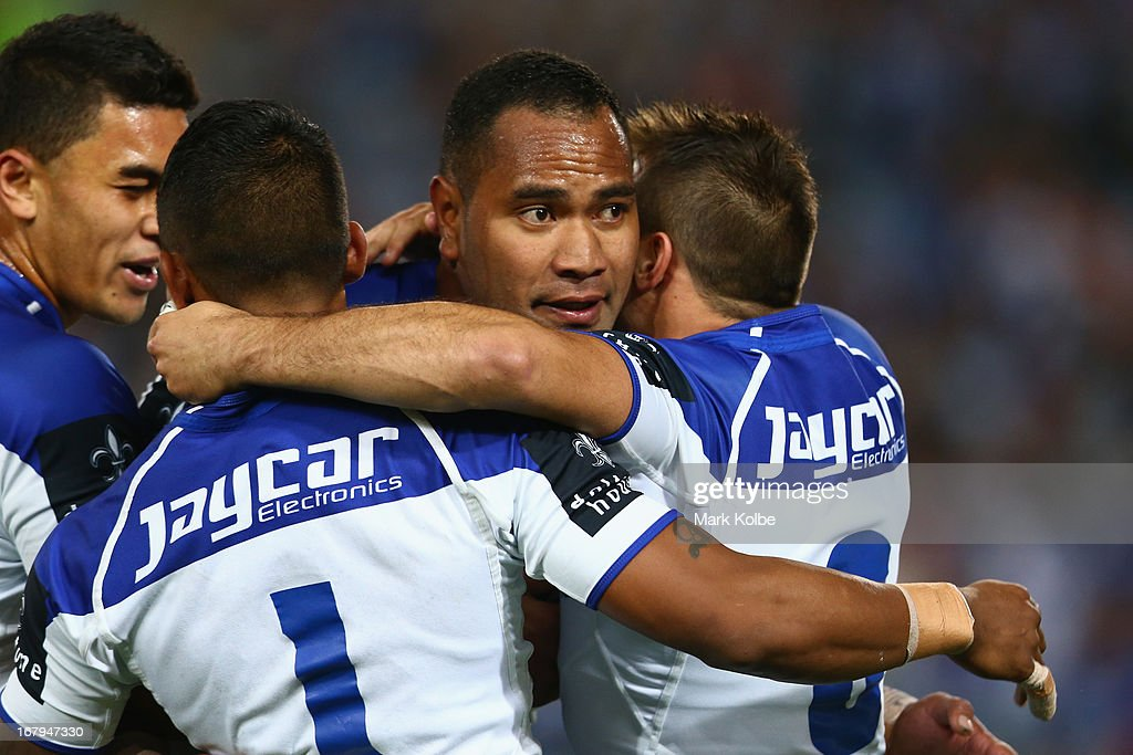 Tony Williams of the Bulldogs celebrates with his team mates after scoring a try the round eight NRL match between the Bulldogs and the Wests Tigers at ANZ Stadium on May 3, 2013 in Sydney, Australia.