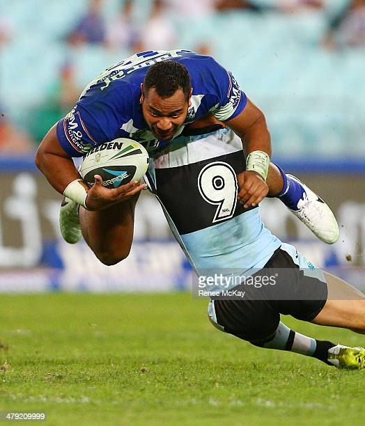 Tony Williams of the Bulldogs is tackled by John Morris during the round two NRL match between the CanterburyBankstown Bulldogs and the...
