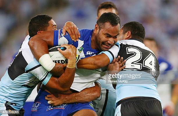 Tony Williams of the Bulldogs is tackled by the Sharks defence during the round two NRL match between the CanterburyBankstown Bulldogs and the...