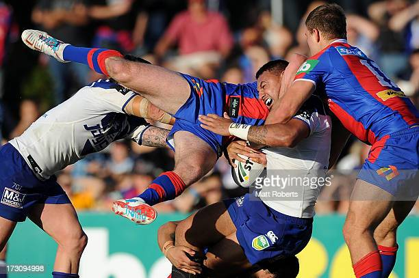 Tony Williams of the Bulldogs is tackled during the round 17 NRL match between the Canterbury Bulldogs and the Newcastle Knights at Virgin Australia...