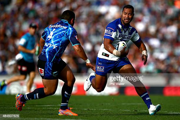 Tony Williams of the Bulldogs looks for a way past Konrad Hurrell of the Warriors during the round 6 NRL match between the New Zealand Warriors and...