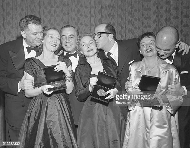 Tony winners pose for a photograph Oscar Hammerstein Gertrude Lawrence and Richard Rodgers of The King and I and the host of the Awards Helen Hayes...