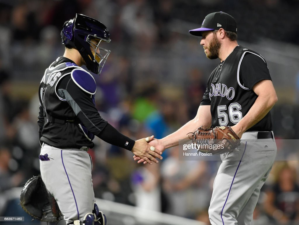 Tony Wolters #14 and Greg Holland #56 of the Colorado Rockies celebrate winning the game against the Minnesota Twins on May 16, 2017 at Target Field in Minneapolis, Minnesota. The Rockies defeated the Twins 7-3.
