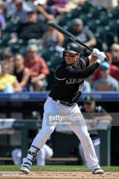 Tony Wolters of the Colorado Rockies bats against the Detroit Tigers in the second inning of a game at Coors Field on August 30 2017 in Denver...
