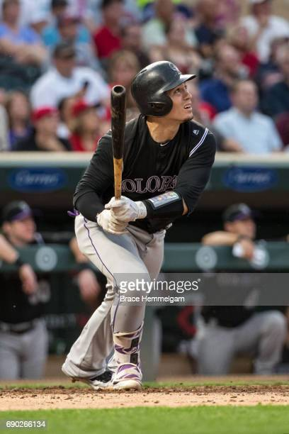 Tony Wolters of the Colorado Rockies bats against the Minnesota Twins on May 16 2017 at Target Field in Minneapolis Minnesota The Rockies defeated...
