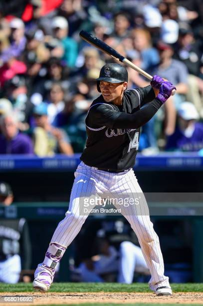 Tony Wolters of the Colorado Rockies bats in the fifth inning of a game against the Los Angeles Dodgers at Coors Field on April 9 2017 in Denver...