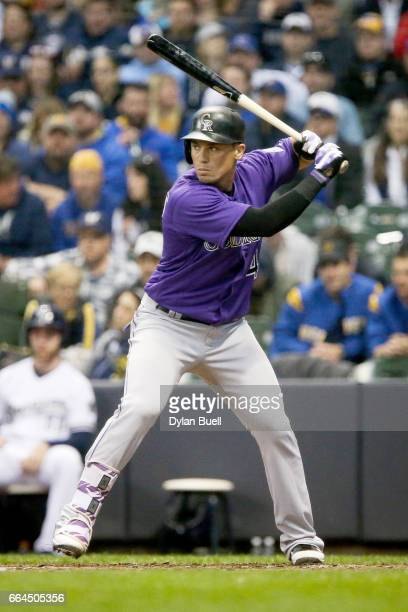 Tony Wolters of the Colorado Rockies bats in the seventh inning against the Milwaukee Brewers of the MLB Opening Day game at Miller Park on April 3...