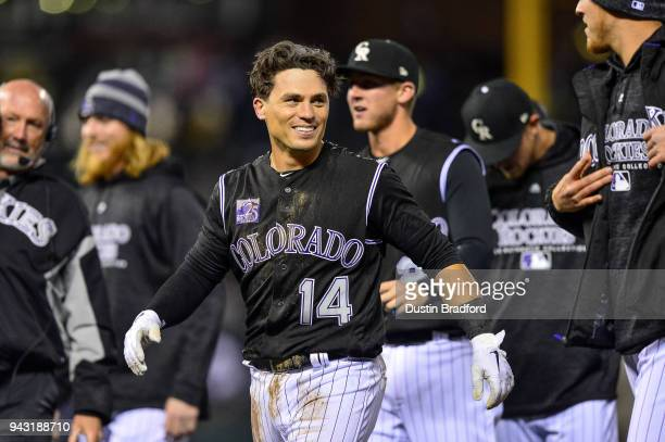 Tony Wolters of the Colorado Rockies celebrates after earning a base on balls with the bases loaded for a walk off RBI walk against the Atlanta...