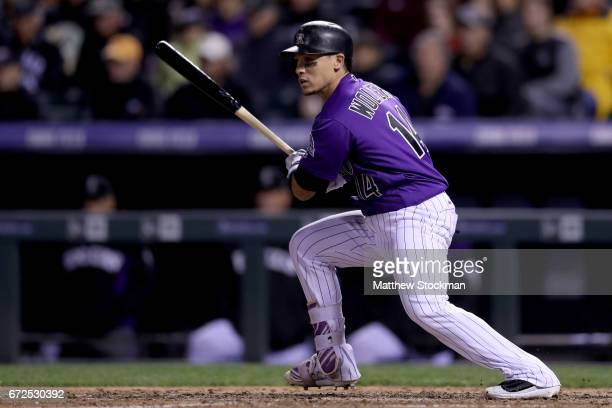 Tony Wolters of the Colorado Rockies hits a RBI single in the eighth inning against the Washington Nationals at Coors Field on April 24 2017 in...