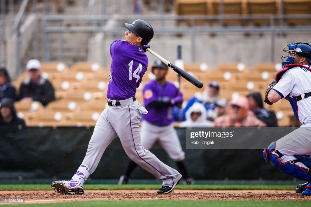 Tony Wolters #14 of the Colorado Rockies hits a three run home run in the fourth inning during a spring training game against the Los Angeles Dodgers at Camelback Ranch on February 27, 2017 in Glendale, Arizona.