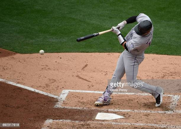Tony Wolters of the Colorado Rockies hits an RBI single during the fourth inning of a baseball game against the San Diego Padres at PETCO Park on...