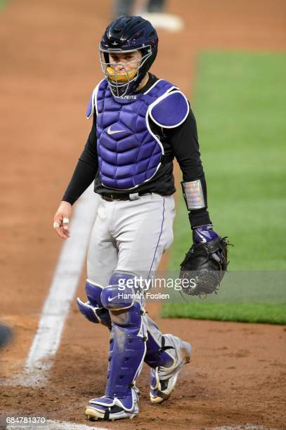 Tony Wolters of the Colorado Rockies looks on while catching the game against the Minnesota Twins on May 16 2017 at Target Field in Minneapolis...