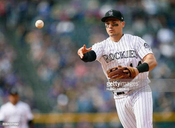 Tony Wolters of the Colorado Rockies makes a play to first base in the sixth inning against the Los Angeles Dodgers at Coors Field on October 1 2017...