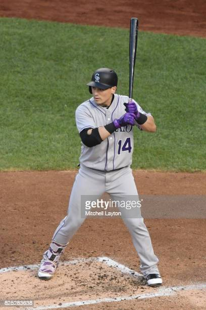Tony Wolters of the Colorado Rockies prepares for a pitch during a baseball game against the Washington Nationals at Nationals Park on July 29 2017...