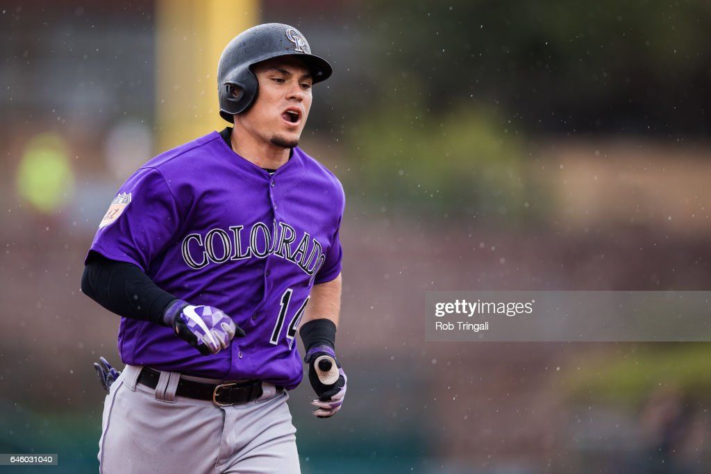 Tony Wolters #14 of the Colorado Rockies rounds the bases after hitting a three run home run in the fourth inning during a spring training game against the Los Angeles Dodgers at Camelback Ranch on February 27, 2017 in Glendale, Arizona.