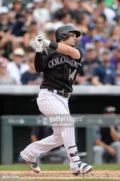 Tony Wolters of the Colorado Rockies singles in the eighth inning of a game against the Detroit Tigers at Coors Field on August 30 2017 in Denver...