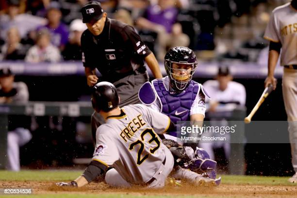 Tony Wolters of the Colorado Rockies tags out David Freese of the Pitsburgh Pirates trying to score in the ninth inning at Coors Field on July 21...
