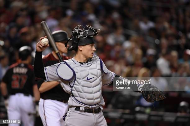 Tony Wolters of the Colorado Rockies throws the ball back to the pitcher against the Arizona Diamondbacks at Chase Field on April 29 2017 in Phoenix...