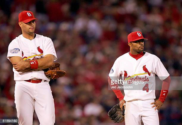 Tony Womack and Albert Pujols of the St Louis Cardinals looks on during game four of the World Series against the Boston Red Sox on October 27 2004...