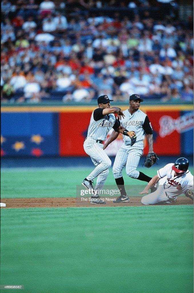 Tony Womack of the Arizona Diamond Backs fields against the Atlanta Braves at Turner Field in Atlanta, Georiga on August 10, 2001.
