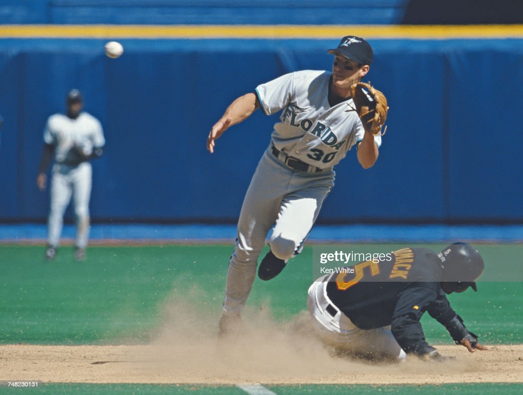 Tony Womack #5 of the Pittsburgh Pirates slides into second base as Craig Counsell of the Florida Marlins tries to tag him out during their Major League Baseball National League Central game on 11 April 1998 at Three Rivers Stadium, Pittsburgh, United States. The Pirates defeated the Marlins 7-6.