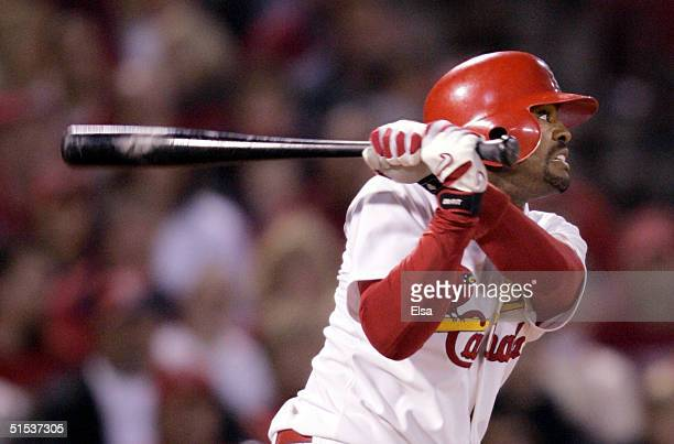 Tony Womack of the St. Louis Cardinals watches his double against the Houston Astros in the third inning of game seven of National League...