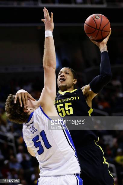 Tony Woods of the Oregon Ducks goes up for a shot over Rob Loe of the Saint Louis Billikens in the first half during the third round of the 2013 NCAA...