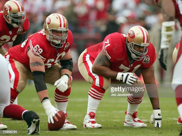 Tony Wragge and Larry Allen of the San Francisco 49ers get ready on the line of scrimmage during the game against the Arizona Cardinals at Monster...