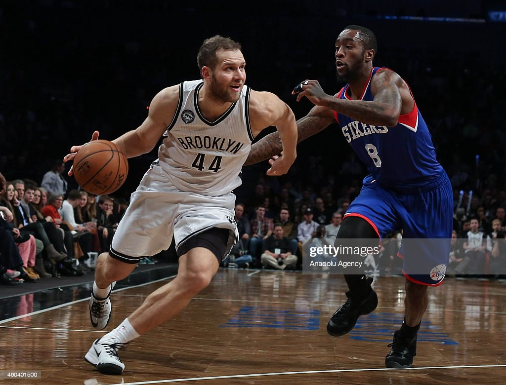 Tony Wroten #8 of Philadelphia 76ers vies with Bojan Bogdanovic #44 of Brooklyn Nets during a basketball game at the Barclays Center on December 12, 2014 in the Brooklyn borough of New York City, NY.