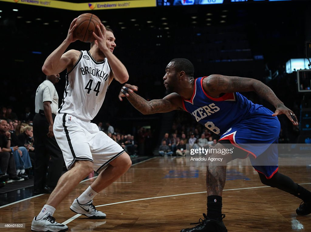 Tony Wroten #8 of Philadelphia 76ers vies with Bojan Bogdanovic #44 of Brooklyn Nets during a basketball game at the Barclays Center on December 12, 2014 in the Brooklyn borough of New York, NY.