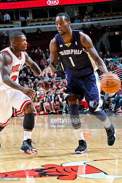 Tony Wroten of the Memphis Grizzlies controls the ball against Nate Robinson of the Chicago Bulls on October 9 2012 at the United Center in Chicago...