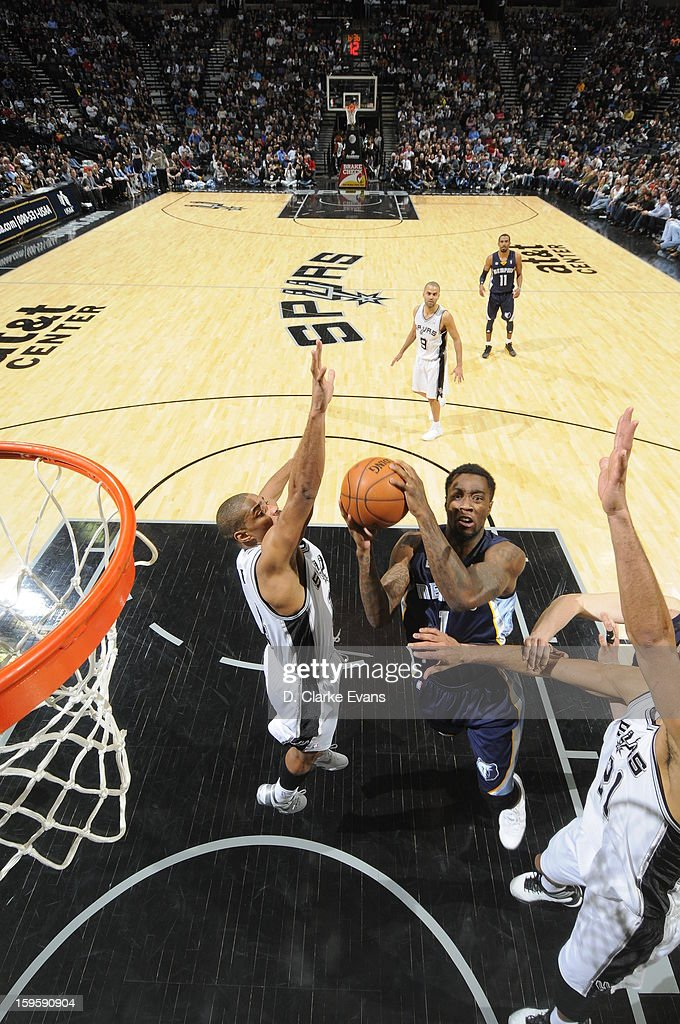 Tony Wroten #1 of the Memphis Grizzlies goes to the basket against Gary Neal #14 of the San Antonio Spurs on January 16, 2013 at the AT&T Center in San Antonio, Texas.