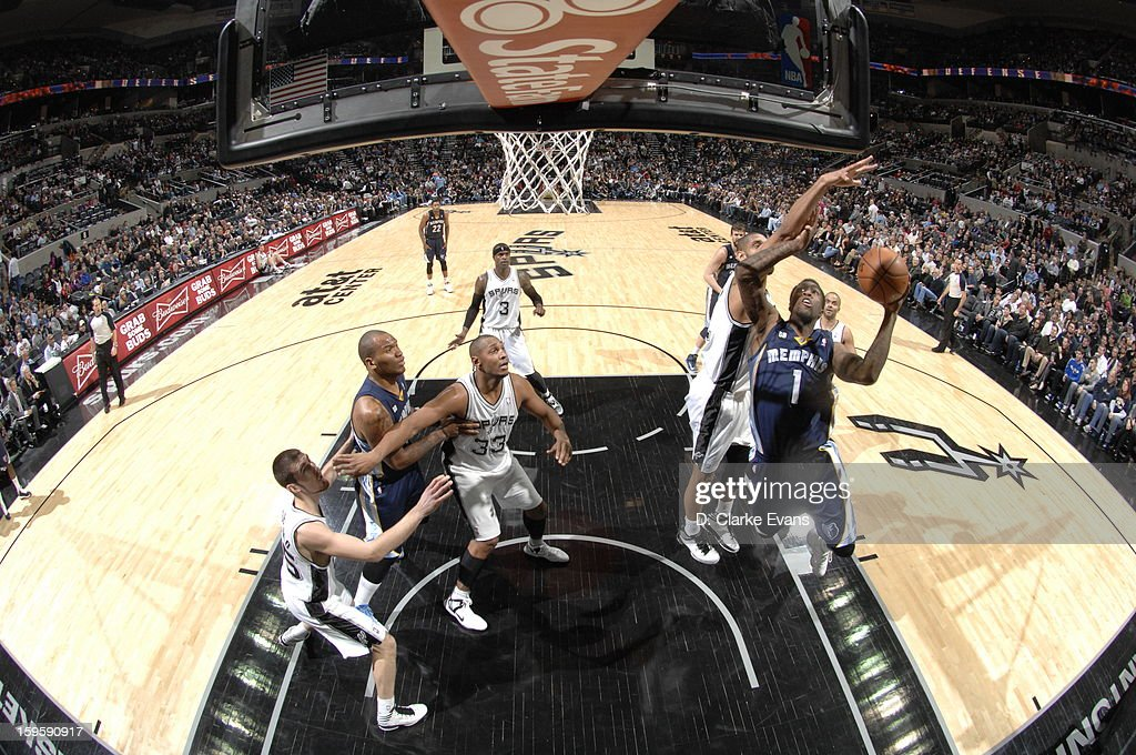 Tony Wroten #1 of the Memphis Grizzlies goes to the basket against Tim Duncan #21 of the San Antonio Spurs on January 16, 2013 at the AT&T Center in San Antonio, Texas.