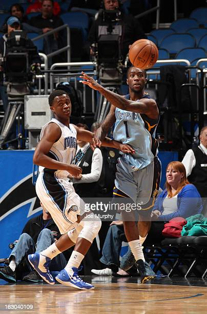 Tony Wroten of the Memphis Grizzlies passes the ball against Doron Lamb of the Orlando Magic on March 3 2013 at Amway Center in Orlando Florida NOTE...
