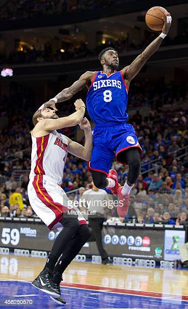 Tony Wroten of the Philadelphia 76ers attempts a layup with Josh McRoberts of the Miami Heat defending on the play on November 1 2014 at the Wells...