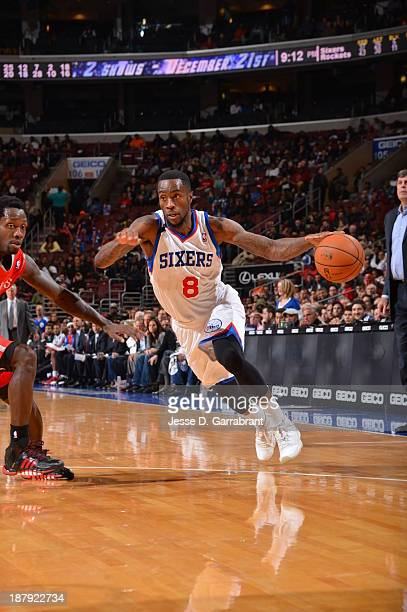 Tony Wroten of the Philadelphia 76ers drives to the basket against the Houston Rockets at the Wells Fargo Center on November 13 2013 in Philadelphia...