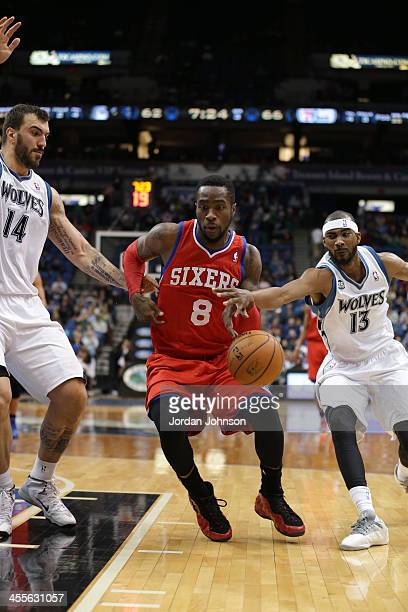 Tony Wroten of the Philadelphia 76ers drives to the basket against the Minnesota Timberwolves on December 11 2013 at Target Center in Minneapolis...