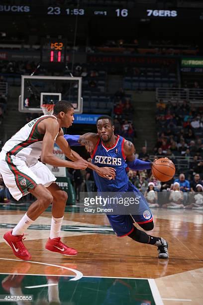 Tony Wroten of the Philadelphia 76ers drives to the basket against Giannis Antetokounmpo of the Milwaukee Bucks on December 21 2013 at the BMO Harris...