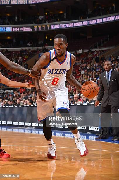 Tony Wroten of the Philadelphia 76ers handles the ball against the Toronto Raptors at the Wells Fargo Center on November 20 2013 in Philadelphia...