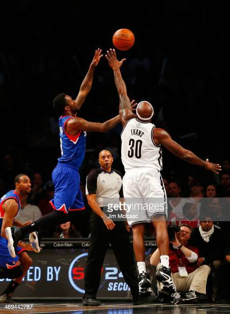 Tony Wroten of the Philadelphia 76ers in action against Reggie Evans of the Brooklyn Nets at Barclays Center on February 3 2014 in the Brooklyn...