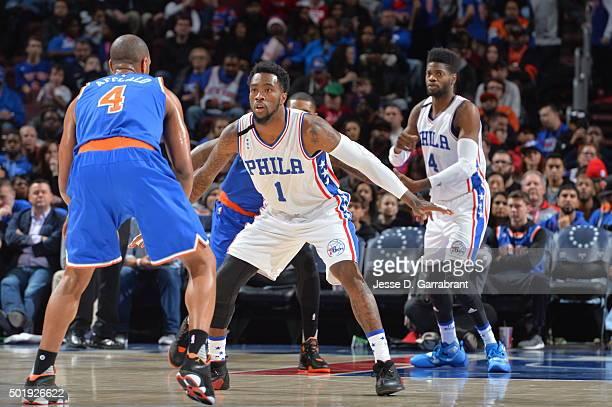 Tony Wroten of the Philadelphia 76ers plays tight defense against the New York Knicks at Wells Fargo Center on December 18 2015 in Philadelphia...