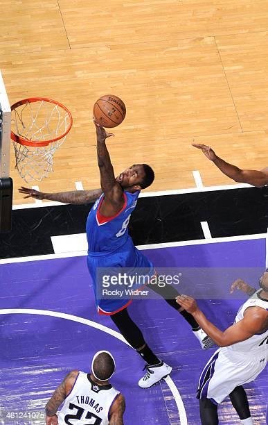 Tony Wroten of the Philadelphia 76ers shoots a layup against the Sacramento Kings on January 2 2014 at Sleep Train Arena in Sacramento California...