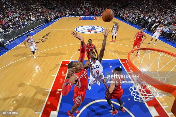 Tony Wroten of the Philadelphia 76ers shoots against Dwight Howard of the Houston Rockets at the Wells Fargo Center on November 13 2013 in...