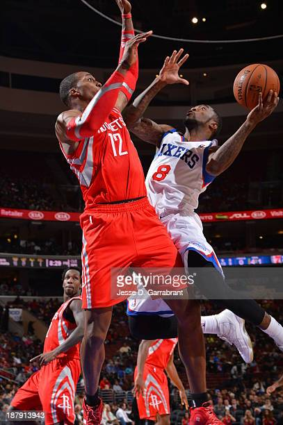 Tony Wroten of the Philadelphia 76ers shoots against Dwight Howard of the Houston Rockets at the Wells Fargo Center on November 13 2013 in...