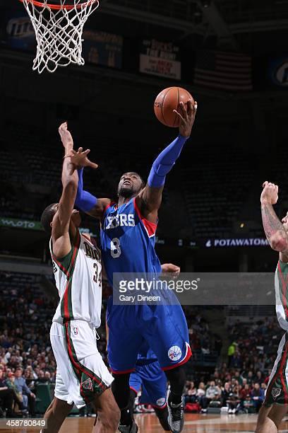 Tony Wroten of the Philadelphia 76ers shoots against Giannis Antetokounmpo of the Milwaukee Bucks on December 21 2013 at the BMO Harris Bradley...
