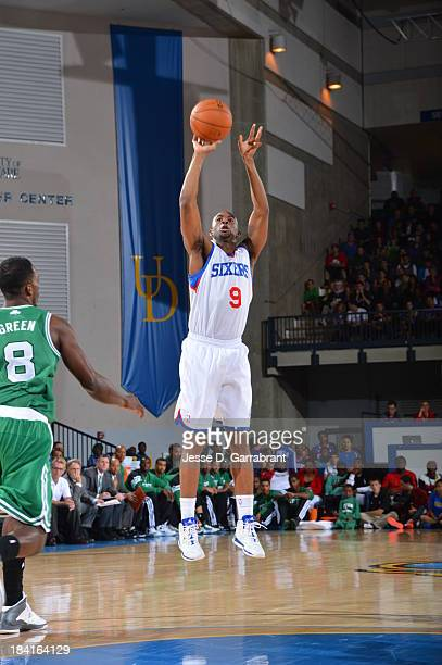 Tony Wroten of the Philadelphia 76ers shoots against the Boston Celtics at the Bob Carpenter Center on October 11 2013 in Newark Delaware NOTE TO...