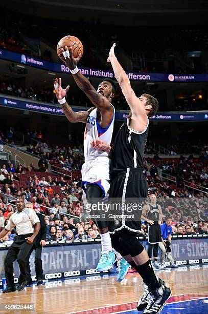 Tony Wroten of the Philadelphia 76ers shoots against the Brooklyn Nets on November 26 2014 at Wells Fargo Center in Philadelphia PA NOTE TO USER User...