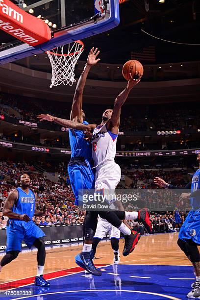 Tony Wroten of the Philadelphia 76ers shoots against the Dallas Mavericks on February 21 2014 at the Wells Fargo Center in Philadelphia Pennsylvania...