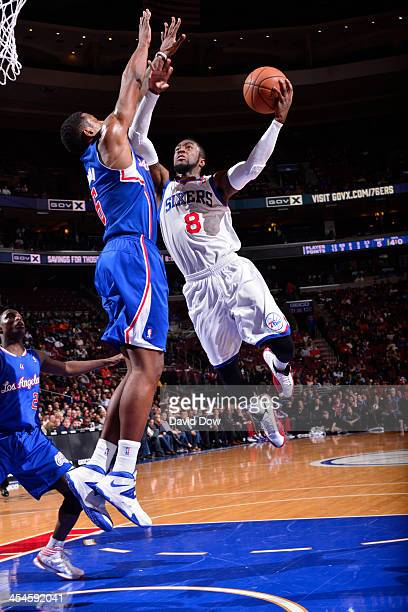 Tony Wroten of the Philadelphia 76ers shoots against the Los Angeles Clippers at the Wells Fargo Center on December 9 2013 in Philadelphia...