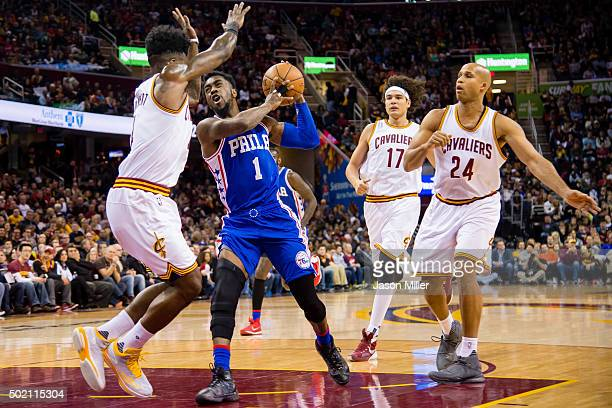 Tony Wroten of the Philadelphia 76ers tries to drive past JR Smith of the Cleveland Cavaliers during the first half at Quicken Loans Arena on...